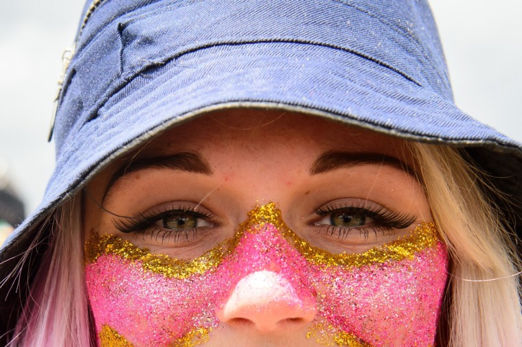 A festival goer shows off her sparkling make-up on the first official day of the Glastonbury Festival of Music and Performing Arts on Worthy Farm in Somerset, south west England, on June 27, 2014. (Leon Neal/Getty Images)
