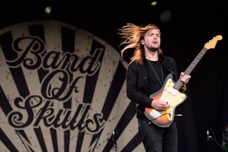 "Russell Marsden, guitarist and singer from British band ""Band of Skulls, performs on the Other Stage, on the first official day of the Glastonbury Festival of Music and Performing Arts in Somerset, southwest England, on June 27, 2014. (Leon Neal/Getty Images)"