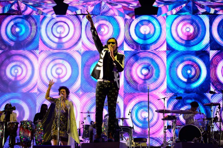 Canadian band Arcade Fire headlines the Pyramid Stage on the first official day of the Glastonbury Festival of Music and Performing Arts on Worthy Farm in Somerset, south west England, on June 27, 2014. (Leon Neal/Getty Images)