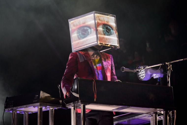 A member of Canadian band Arcade Fire plays keyboards as the group headlines the Pyramid Stage on the first official day of the Glastonbury Festival of Music and Performing Arts on Worthy Farm in Somerset, south west England, on June 27, 2014. (Leon Neal/Getty Images)
