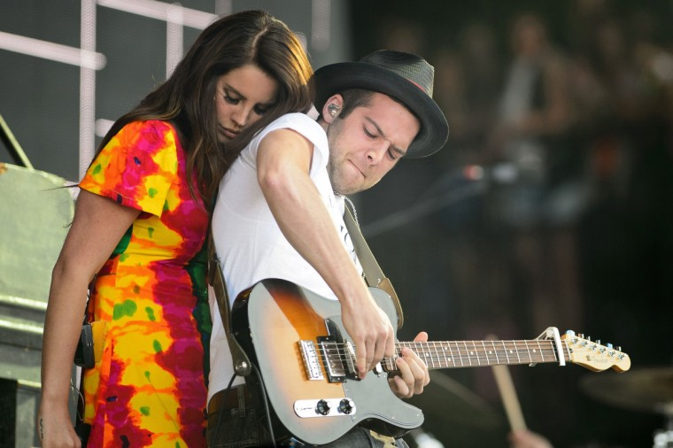 US singer Lana Del Rey (L) interacts with her guitarist as she performs on the Pyramid Stage, on the second day of the Glastonbury Festival of Music and Performing Arts in Somerset, southwest England, on June 28, 2014. (Leon Neal/Getty Images)