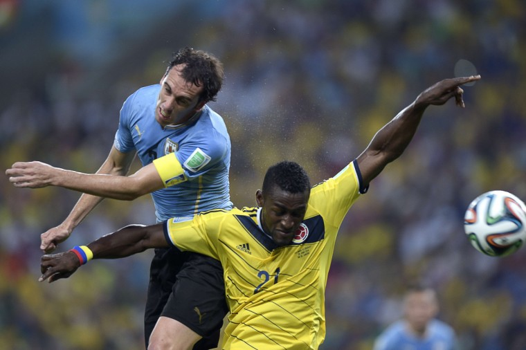 Uruguay's defender Diego Godin (L) vies with Colombia's forward Jackson Martinez, during the Round of 16 football match between Colombia and Uruguay at the Maracana Stadium in Rio de Janeiro during the 2014 FIFA World Cup on June 28, 2014. (Daniel Garcia/Getty Images)