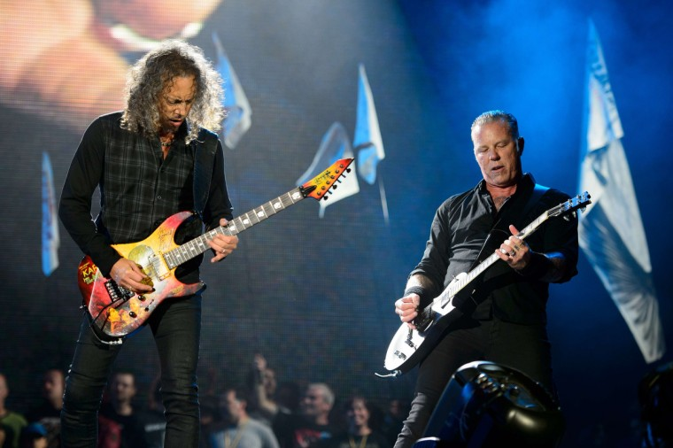 Kirk Hammett (L) and James Hetfield of US metal band Metallica performs on the Pyramid Stage, on the second day of the Glastonbury Festival of Music and Performing Arts on Worthy Farm in Somerset, south west England, on June 28, 2014. (Leon Neal/Getty Images)