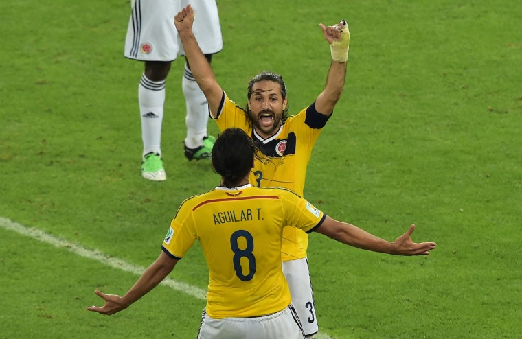 Colombia's players celebrate after the Round of 16 football match between Colombia and Uruguay at the Maracana Stadium in Rio de Janeiro during the 2014 FIFA World Cup in Brazil on June 28, 2014. (Gabriel Bouys/Getty Images)