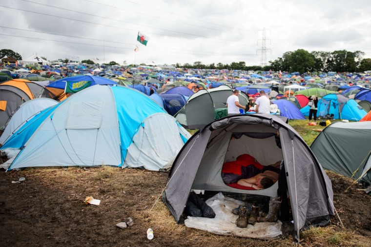 Revellers wake on the last day of the Glastonbury Festival of Music and Performing Arts in Somerset, southwest England, on June 29, 2014. (Leon Neal/Getty Images)