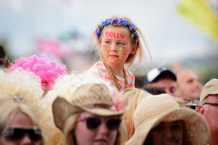 Fans enjoy the music as US singer Dolly Parton performs on the Pyramid Stage, on the final day of the Glastonbury Festival of Music and Performing Arts on Worthy Farm in Somerset, southwest England, on June 29, 2014. (Leon Neal/Getty Images)