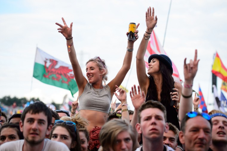 Fans enjoy the music as US group The Black Keys performs on the Pyramid Stage on the final day of the Glastonbury Festival of Music and Performing Arts on Worthy Farm in Somerset, south west England, on June 29, 2014. (Leon Neal/Getty Images)
