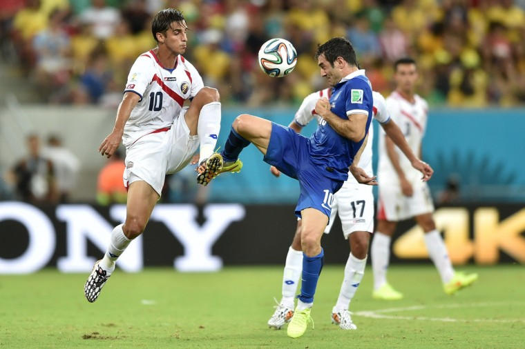 Costa Rica's forward and captain Bryan Ruiz (L) vies with Greece's midfielder Giorgos Karagounis, during a Round of 16 football match between Costa Rica and Greece at Pernambuco Arena in Recife during the 2014 FIFA World Cup on June 29, 2014. (Aris Messinis/Getty Images)