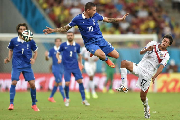 Greece's defender Jose Holebas (L) vies with Costa Rica's midfielder Yeltsin Tejeda, during a Round of 16 football match between Costa Rica and Greece at Pernambuco Arena in Recife during the 2014 FIFA World Cup on June 29, 2014. (Aris Messinis/Getty Images)