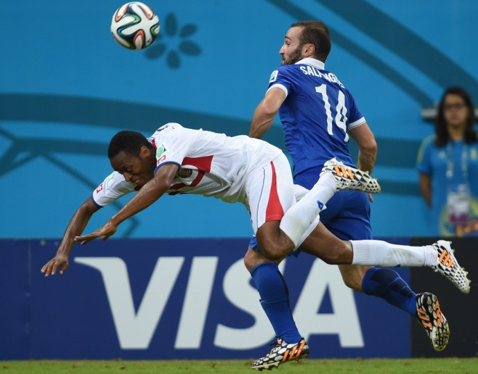 Costa Rica's defender Junior Diaz (L) vies with Greece's forward Dimitris Salpingidis during a Round of 16 football match between Costa Rica and Greece at Pernambuco Arena in Recife during the 2014 FIFA World Cup on June 29, 2014. (Pedro Ugarte/Getty Images)