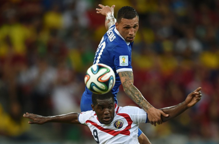 Costa Rica's forward Joel Campbell vies with Greece's defender Jose Holebas (R) during a Round of 16 football match between Costa Rica and Greece at Pernambuco Arena in Recife during the 2014 FIFA World Cup on June 29, 2014. (Pedro Ugarte/Getty Images)