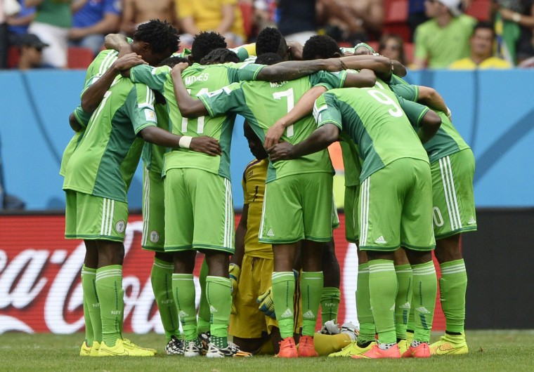 Nigeria's players huddle during the round of 16 football match between France and Nigeria at the Mane Garrincha National Stadium in Brasilia during the 2014 FIFA World Cup on June 30, 2014. (Franck Fife/Getty Images)