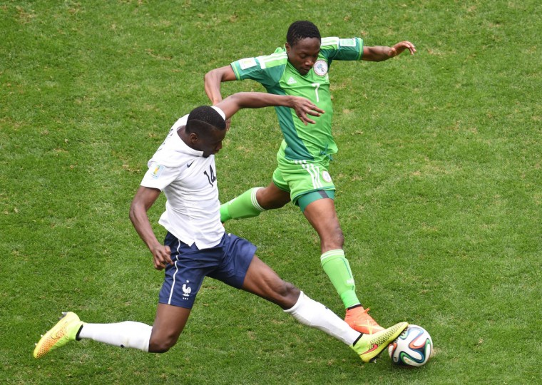 France's midfielder Blaise Matuidi (L) vies with Nigeria's forward Ahmed Musa during a Round of 16 football match between France and Nigeria at Mane Garrincha National Stadium in Brasilia during the 2014 FIFA World Cup on June 30, 2014. (Evaristo Sa/Getty Images)