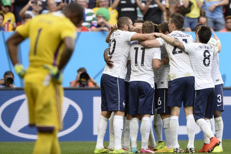 France's players celebrate after scoring a goal during the round of 16 football match between France and Nigeria at the Mane Garrincha National Stadium in Brasilia during the 2014 FIFA World Cup on June 30, 2014. (Franck Fife/Getty Images)