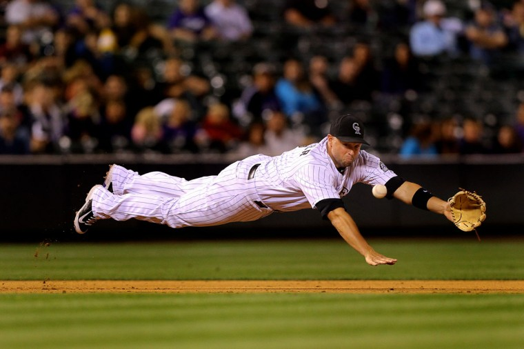 Third baseman Michael Cuddyer #3 of the Colorado Rockies dives but comes up short on a base hit by Miguel Montero (not pictured) of the Arizona Diamondbacks during the ninth inning at Coors Field on June 5, 2014 in Denver, Colorado. (Justin Edmonds/Getty Images)