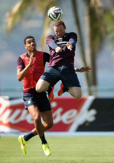 Chris Smalling of England (L) in action with Wayne Rooney of England during a training session at the Urca military base (Forte de Urca) training ground on June 9, 2014 in Rio de Janeiro, Brazil. (Richard Heathcote/Getty Images)