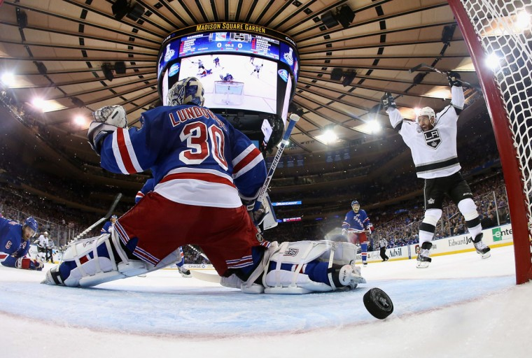 Dwight King #74 of the Los Angeles Kings celebrates a goal on Henrik Lundqvist #30 of the New York Rangers by Jeff Carter #77 of the Los Angeles Kings during the first period of Game Three of the 2014 NHL Stanley Cup Final at Madison Square Garden on June 9, 2014 in New York, New York. (Bruce Bennett/Getty Images)