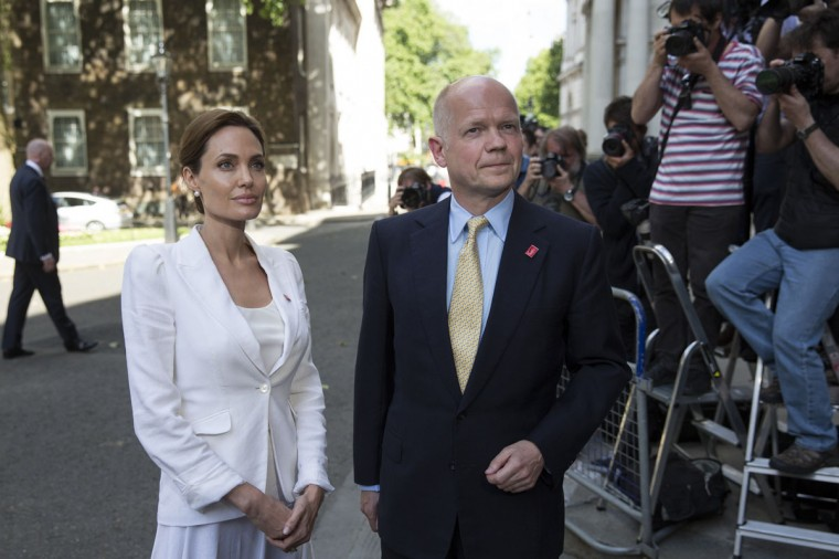 UN Special Envoy and actress Angelina Jolie arrives in Downing Street with British Foreign Secretary William Hague after having attended the Global Summit To End Sexual Violence In Conflict at the ExCeL centre on June 10, 2014 in London, England. The four-day conference on sexual violence in war is hosted by Foreign Secretary William Hague and UN Special Envoy and actress Angelina Jolie. (Oli Scarff/Getty Images)
