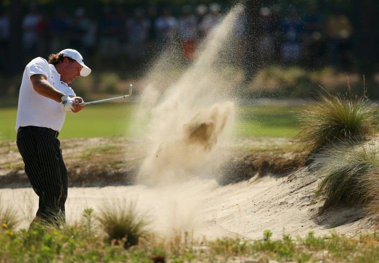 Phil Mickelson of the United States hits a shot from a bunker during a practice round prior to the start of the 114th U.S. Open at Pinehurst Resort & Country Club, Course No. 2 on June 10, 2014 in Pinehurst, North Carolina. (Tyler Lecka/Getty Images)