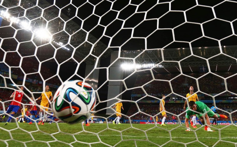 Jorge Valdivia of Chile (obscured) shoots and scores his teams second goal against goalkeeper Mathew Ryan of Australia during the 2014 FIFA World Cup Brazil Group B match between Chile and Australia at Arena Pantanal on June 13, 2014 in Cuiaba, Brazil. (Matthew Lewis/Getty Images)