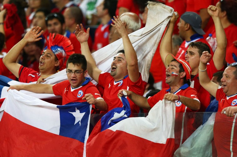 Chile fans cheer during the 2014 FIFA World Cup Brazil Group B match between Chile and Australia at Arena Pantanal on June 13, 2014 in Cuiaba, Brazil. (Clive Brunskill/Getty Images)