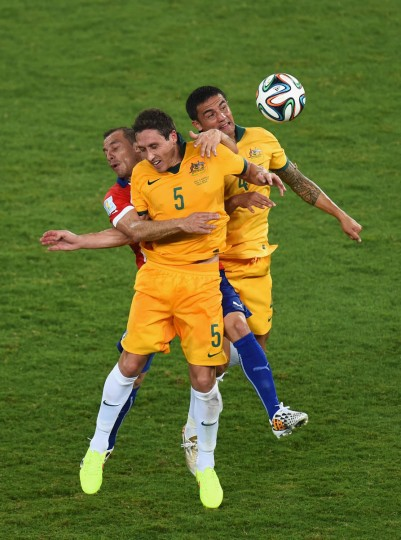 Marcelo Diaz of Chile goes up for a header against Mark Milligan (Center) and Tim Cahill of Australia during the 2014 FIFA World Cup Brazil Group B match between Chile and Australia at Arena Pantanal on June 13, 2014 in Cuiaba, Brazil. (Stu Forster/Getty Images)