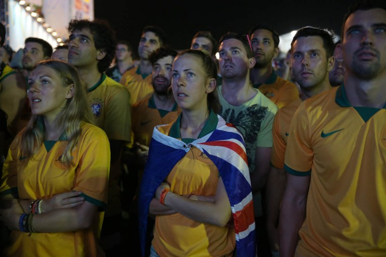 Australian football team fans watch play against Chile on the giant screen showing the match at the FIFA World Cup Fan Fest on Copacabana beach on June 13, 2014 in Rio de Janeiro, Brazil. The match was played on the second day of the World Cup tournament. (Joe Raedle/Getty Images)