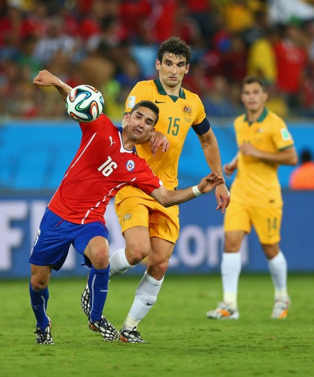 Felipe Gutierrez of Chile is challenged by Mile Jedinak of Australia during the 2014 FIFA World Cup Brazil Group B match between Chile and Australia at Arena Pantanal on June 13, 2014 in Cuiaba, Brazil. (Clive Brunskill/Getty Images)