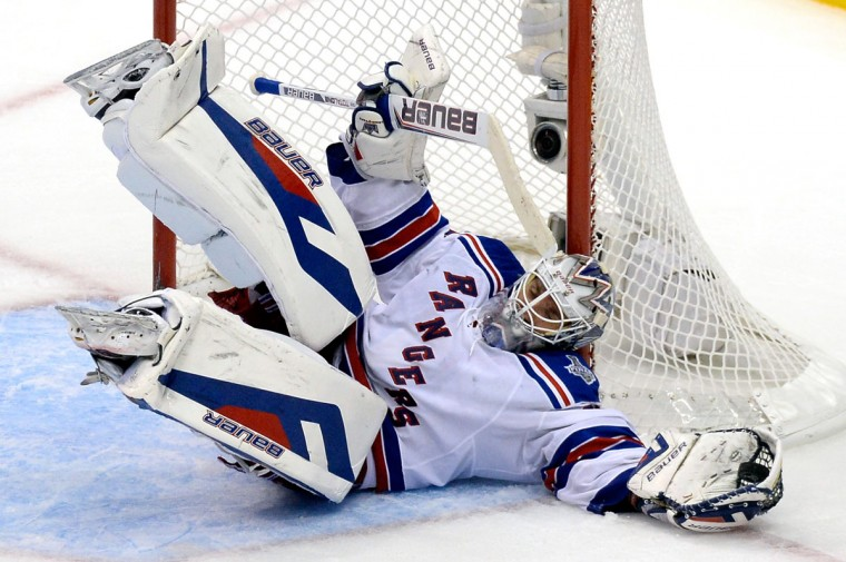 Goaltender Henrik Lundqvist #30 of the New York Rangers makes a save in the third period against the Los Angeles Kings during Game Five of the 2014 Stanley Cup Final at Staples Center on June 13, 2014 in Los Angeles, California. (Kevork Djansezian/Getty Images)