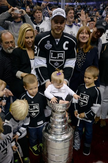 Dustin Brown #23 of the Los Angeles Kings celebrates with the Stanley Cup in celebration after defeating the New York Rangers 3-2 in double overtime of Game Five of the 2014 Stanley Cup Final at Staples Center on June 13, 2014 in Los Angeles, California. (Harry How/Getty Images)