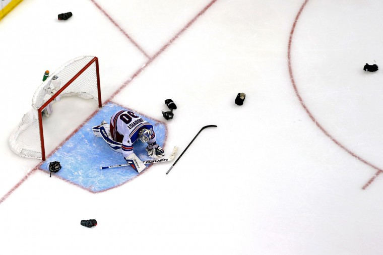 Goaltender Henrik Lundqvist #30 of the New York Rangers reacts after being defeated by the Los Angeles Kings 3-2 in Game Five of the 2014 Stanley Cup Final at Staples Center on June 13, 2014 in Los Angeles, California. (Bruce Bennett/Getty Images)