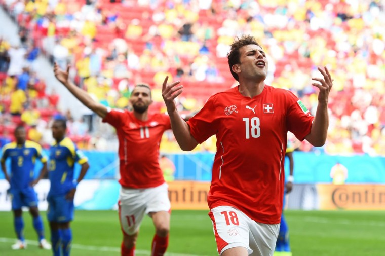Admir Mehmedi of Switzerland celebrates scoring his team's first goal during the 2014 FIFA World Cup Brazil Group E match between Switzerland and Ecuador at Estadio Nacional on June 15, 2014 in Brasilia, Brazil. (Stu Forster/Getty Images)