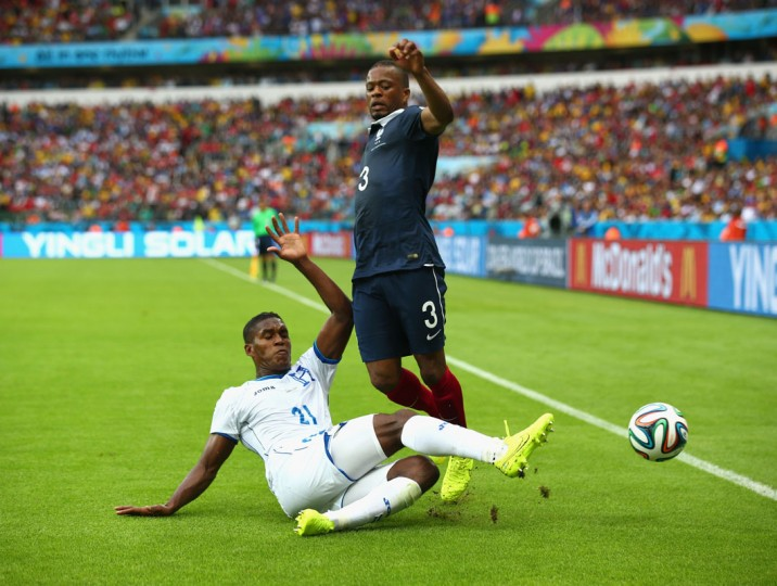 Brayan Beckeles of Honduras challenges Patrice Evra of France during the 2014 FIFA World Cup Brazil Group E match between France and Honduras at Estadio Beira-Rio on June 15, 2014 in Porto Alegre, Brazil. (Ian Walton/Getty Images)