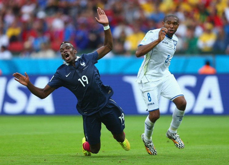 Wilson Palacios of Honduras fouls Paul Pogba of France resulting in a penalty kick during the 2014 FIFA World Cup Brazil Group E match between France and Honduras at Estadio Beira-Rio on June 15, 2014 in Porto Alegre, Brazil. (Jeff Gross/Getty Images)