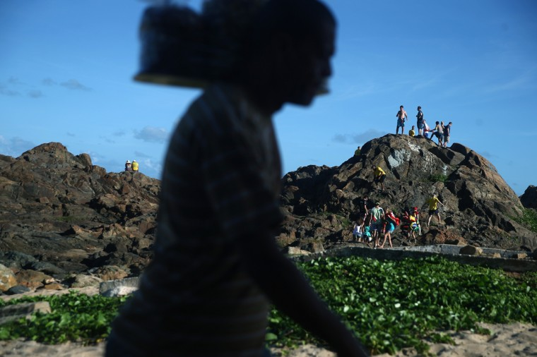 Fans gather on a hill at Farol da Barra for a Fan Fest prior to the Brazil-Mexico match in the 2014 FIFA World Cup on June 17, 2014 in Salvador, Brazil. Today is the sixth day of the World Cup and the second match for home team Brazil. (Getty Images/Mario Tama)
