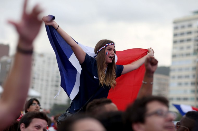 French soccer team fans watch their team play against the Switzerland team as they watch on the screen setup at the Word Cup FIFA Fan Fest during on Copacabana beach June 20, 2014 in Rio de Janeiro, Brazil. Italy lost 1-0. (Photo by Joe Raedle/Getty Images)