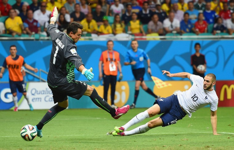 Karim Benzema of France celebrates scoring his team's fourth goal past goalkeeper Diego Benaglio of Switzerland during the 2014 FIFA World Cup Brazil Group E match between Switzerland and France at Arena Fonte Nova on June 20, 2014 in Salvador, Brazil. (Photo by Christopher Lee/Getty Images)