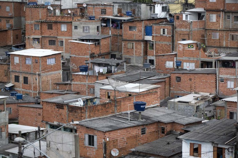 Dense, low-quality housing in the poor neighbourhood of Itaquera, adjacent to the 'Arena de Sao Paulo' stadium, on June 21, 2014 in Sao Paulo, Brazil. The Arena de Sao Paulo, which is reported to have cost in excess of 200 million GBP, hosted the opening match of the 2014 FIFA World Cup and has a capacity of over 61,000. The total cost borne by Brazil for staging the 2014 World Cup is estimated to be 6.5 billion GBP, which critics have argued would have better spent on the millions of Brazilians living in poverty. (Photo by Oli Scarff/Getty Images)