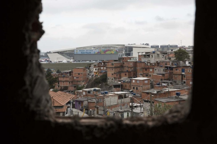 The large 'Arena de Sao Paulo' stadium dominates the skyline above the poor neighbourhood of Itaquera on June 21, 2014 in Sao Paulo, Brazil. The Arena de Sao Paulo, which is reported to have cost in excess of 200 million GBP, hosted the opening match of the 2014 FIFA World Cup and has a capacity of over 61,000. The total cost borne by Brazil for staging the 2014 World Cup is estimated to be 6.5 billion GBP, which critics have argued would have better spent on the millions of Brazilians living in poverty. (Photo by Oli Scarff/Getty Images)
