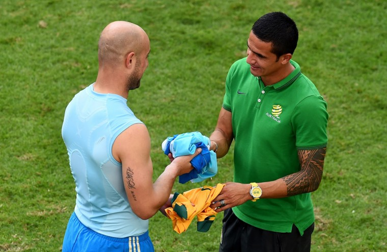 Pepe Reina of Spain and Tim Cahill of Australia interact after Spain's 3-0 win during the 2014 FIFA World Cup Brazil Group B match between Australia and Spain at Arena da Baixada on June 23, 2014 in Curitiba, Brazil. (Photo by David Ramos/Getty Images)