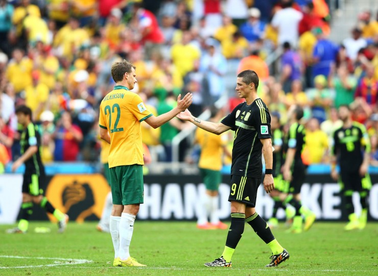 Alex Wilkinson of Australia and Fernando Torres of Spain shake hands after Spain's 3-0 win during the 2014 FIFA World Cup Brazil Group B match between Australia and Spain at Arena da Baixada on June 23, 2014 in Curitiba, Brazil. (Photo by Paul Gilham/Getty Images)