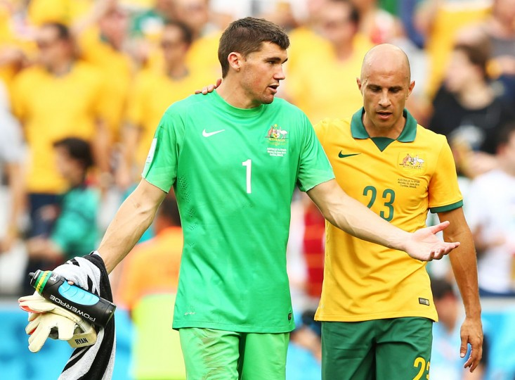 Goalkeeper Mathew Ryan and Mark Bresciano of Australia look on after being defeated by Spain 3-0 during the 2014 FIFA World Cup Brazil Group B match between Australia and Spain at Arena da Baixada on June 23, 2014 in Curitiba, Brazil. (Photo by Quinn Rooney/Getty Images)