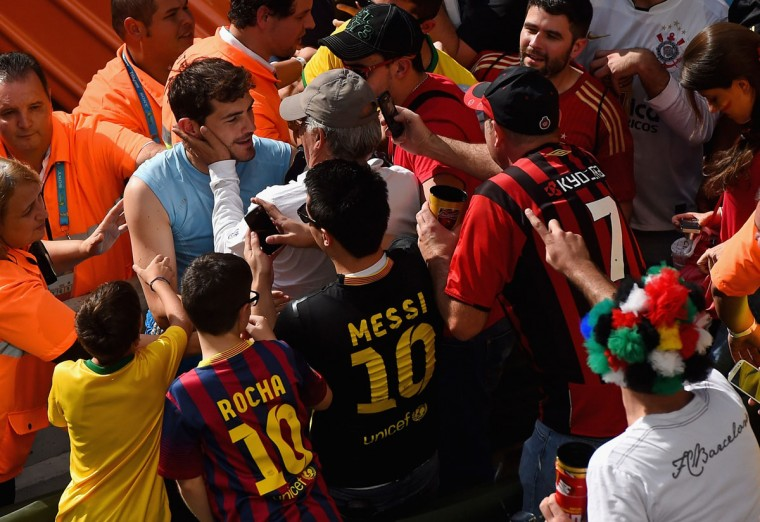 Iker Casillas of Spain interacts with fans after defeating Australia 3-0 during the 2014 FIFA World Cup Brazil Group B match between Australia and Spain at Arena da Baixada on June 23, 2014 in Curitiba, Brazil. (Photo by David Ramos/Getty Images)