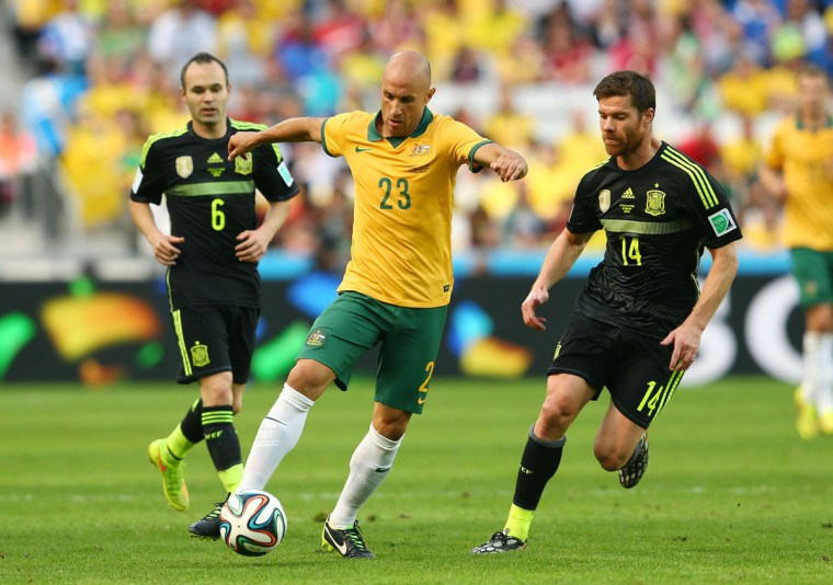 Mark Bresciano of Australia controls the ball against Andres Iniesta (left) and Xabi Alonso of Spain during the 2014 FIFA World Cup Brazil Group B match between Australia and Spain at Arena da Baixada on June 23, 2014 in Curitiba, Brazil. (Photo by Cameron Spencer/Getty Images)