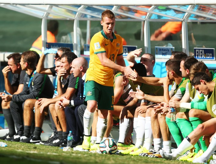 Oliver Bozanic of Australia reacts with teammates after exiting the game during the 2014 FIFA World Cup Brazil Group B match between Australia and Spain at Arena da Baixada on June 23, 2014 in Curitiba, Brazil. (Photo by Jeff Gross/Getty Images)