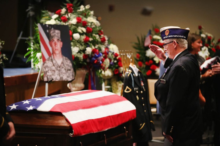 A veteran pays his respects to U.S. Army PFC Aaron Toppen during a visitation at Parkview Christian Church in Mokena, Illinois. Toppen, 19, was killed alongside four other American soldiers and an Afghan soldier in a friendly fire airstrike while they were engaged in a firefight earlier this month in Afghanistan. (Scott Olson/Getty Images)