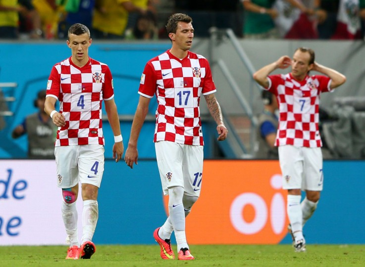 From left, Ivan Perisic, Mario Mandzukic and Ivan Rakitic of Croatia walk off the pitch after a 3-1 defeat to Mexico in the 2014 FIFA World Cup Brazil Group A match at Arena Pernambuco on June 23, 2014 in Recife, Brazil. (Photo by Michael Steele/Getty Images)