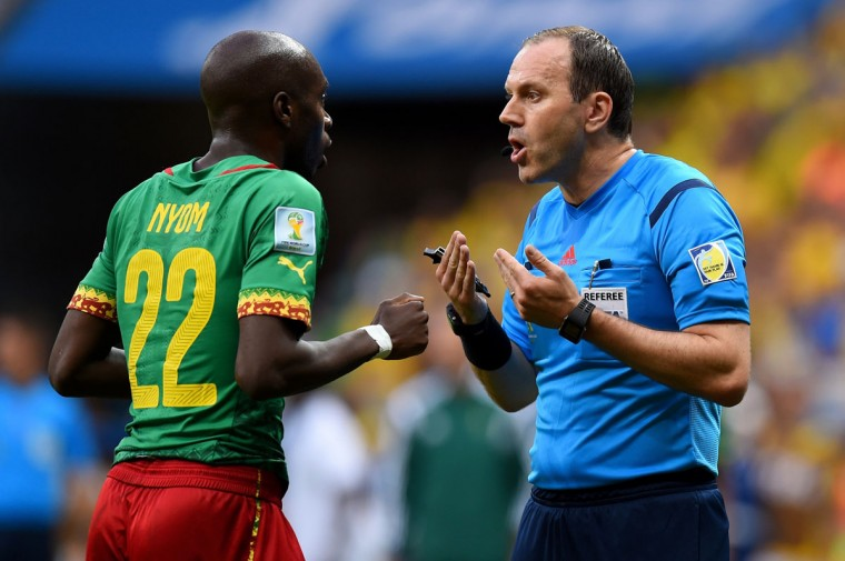 Referee Jonas Eriksson speaks to Allan Nyom of Cameroon during the 2014 FIFA World Cup Brazil Group A match on June 23, 2014 in Brasilia, Brazil. (Photo by Stu Forster/Getty Images)