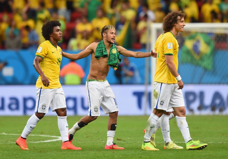 From left, Willian, Neymar and David Luiz of Brazil react after defeating Cameroon 4-1 during the 2014 FIFA World Cup Brazil Group A match at Estadio Nacional on June 23, 2014 in Brasilia, Brazil. (Photo by Stu Forster/Getty Images)
