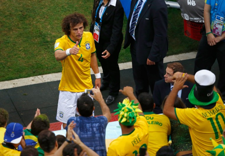 David Luiz of Brazil acknowledges the fans after defeating Cameroon 4-1 during the 2014 FIFA World Cup Brazil Group A match at Estadio Nacional on June 23, 2014 in Brasilia, Brazil. (Photo by Phil Walter/Getty Images)